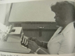 Sherry Lenzy showing off her typing skills.  1976 - 1977