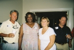 Roy Oldham, Lou Foreman Williams, Wendy Phillips Little pose for the camera.  Britt Laughinghouse appears to be a specta