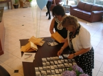 Kathy and Ann Marie sorting the name tags before our classmates arrive.  Had a few chuckles too with what we looked like