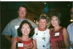 Mike and wife, Nancy, posing for a photo with classmates Susie and Rushell.